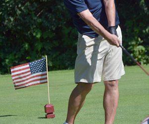 Mayor playing golf
